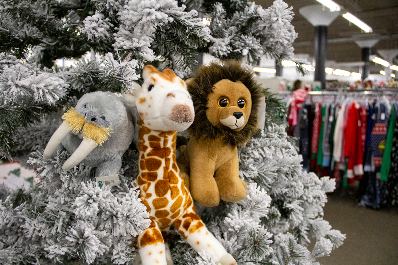 Stuffed animals nestled in a Christmas tree.
