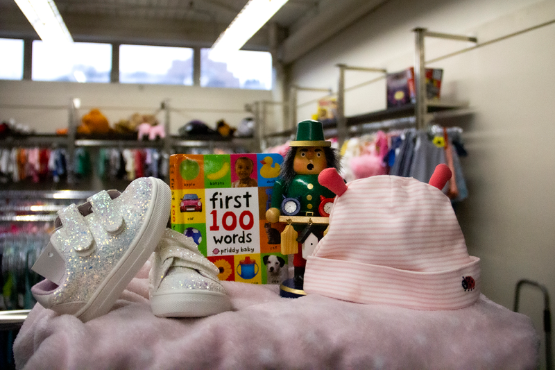 Baby shoes and hat and a book.